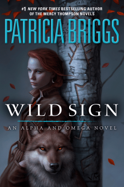 red haired woman leans against a tree with a werewolf in her arms book review for wild sign by patricia briggs